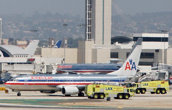 US Airways se fusiona con la endeudada American Airlines