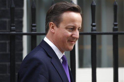Cameron hoy a la salida del número 10 de Downing Street en Londres.