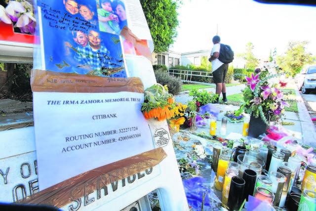 Familiares y amigos de las víctimas levantaron  un altar con fotos, flores y mensajes en el lugar donde ocurrió el accidente.