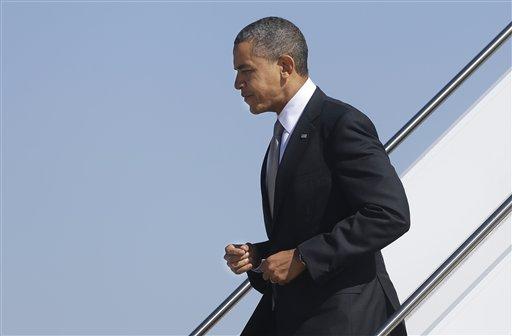 Obama llega a Universidad de Denver para debate (Fotos)