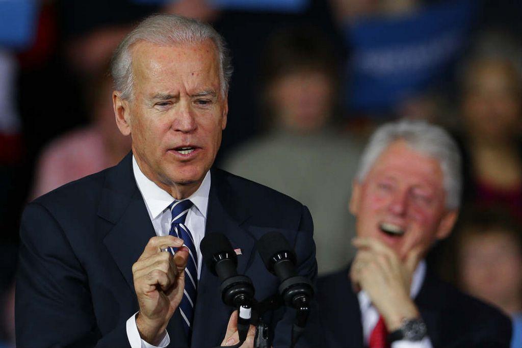 Biden y Clinton critican a Romney en Ohio [Fotos]