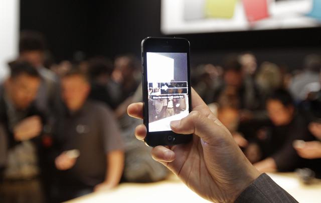 Aplicación que simula un iPhone triunfa en China (Fotos)