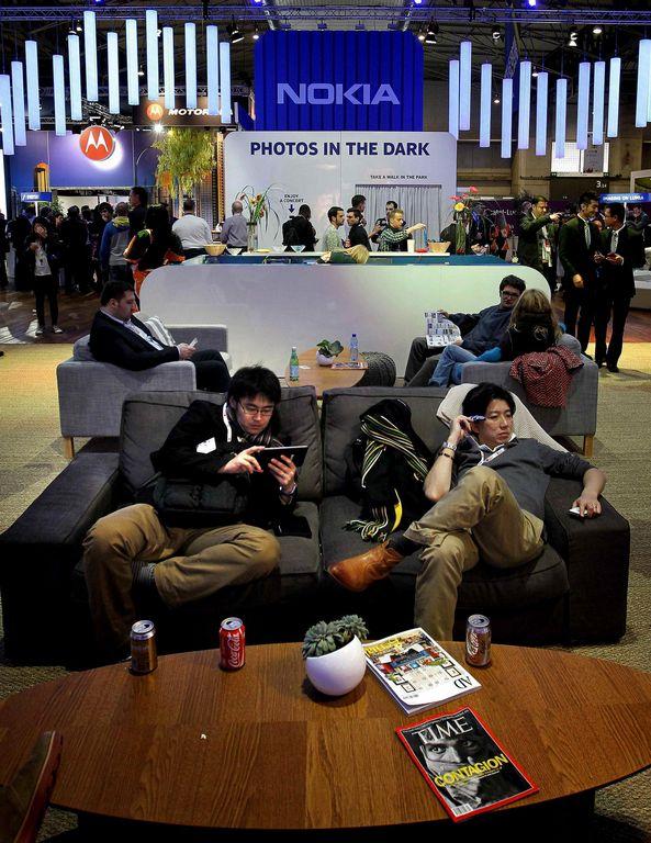 Visitantes en el Mobile World Congress.