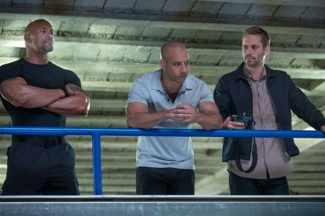 """La sexta película de """"Rápidos y furiosos"""" se desarrolla en el extranjero, lo que creó una expectativa diferente. En la foto, los actores Vin Diesel (centro), Dwayne Johnson (izquierda) y Paul Walker."""