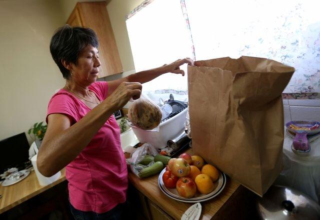 Obama firmará ley que recorta cupones de alimentos