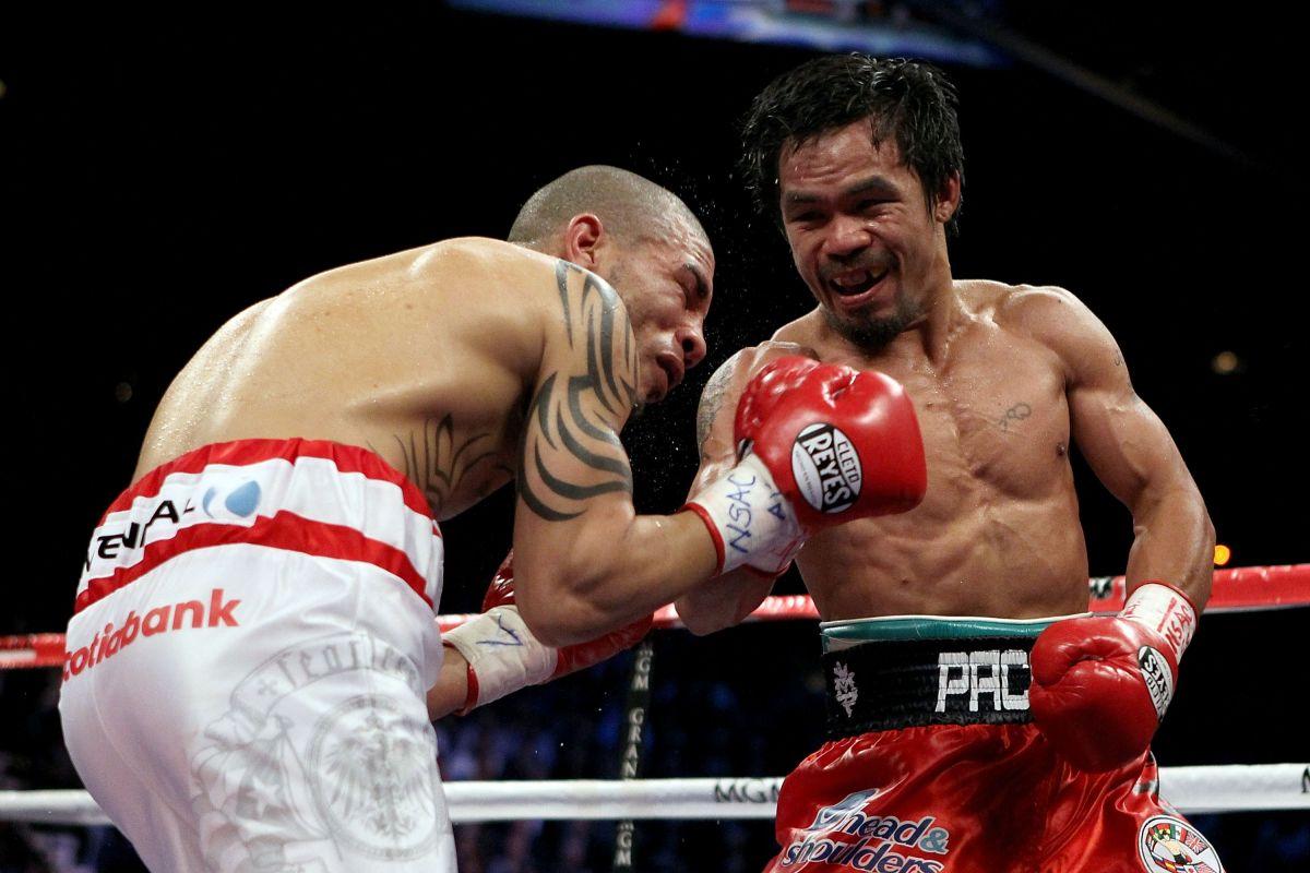 Miguel Cotto ha peleado menos rounds que 'Canelo' Álvarez, aunque le han pegado más, como cuando se enfrentó a Manny Pacquiao (foto) en 2009.