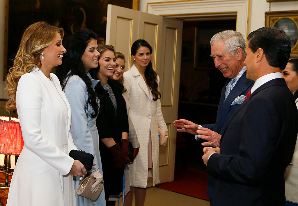 LONDON, ENGLAND - MARCH 03:  Prince Charles, Prince of Wales (2nd R) is introduced to the daughters of Mexico Enrique Pena Nieto (R) and first lady Angelica Rivera during a visit to Clarence House on March 3, 2015 in London, England.  The President of Mexico, accompanied by Senora Angelica Rivera de Pena, are on a State Visit to the United Kingdom as the guests of Her Majesty The Queen from Tuesday 3rd March to Thursday 5th March.  (Photo by Kirsty Wigglesworth - WPA Pool /Getty Images)