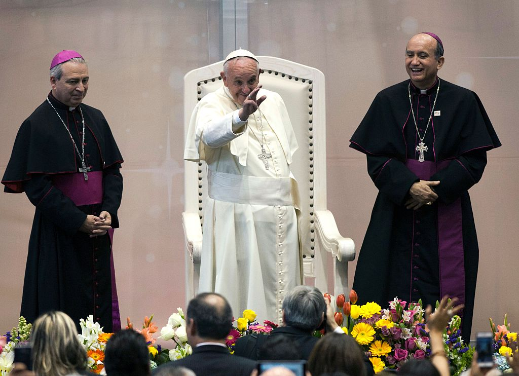 """Pope Francis waves upon arrival at the Bachilleres College in Ciudad Juarez, Mexico on February 17, 2016. Pope Francis urged Mexican convicts on Wednesday to become """"prophets"""" whose experiences through """"hell"""" can help the country break its cycle of violence as he visited a crime-scarred city's prison. AFP PHOTO / JULIO CESAR AGUILAR / AFP / Julio Cesar Aguilar Fuentes (Photo credit should read JULIO CESAR AGUILAR FUENTES/AFP/Getty Images)"""