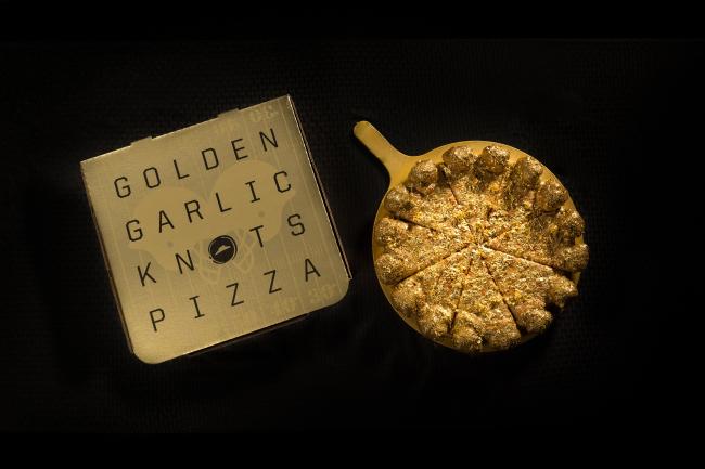 Preparan pizza de oro para el Super Bowl