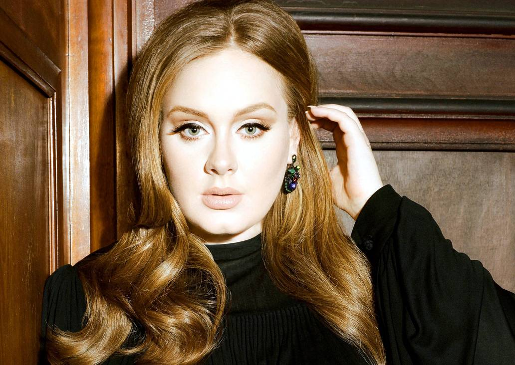 Adele sorprende luciendo una nueva y esbelta figura.