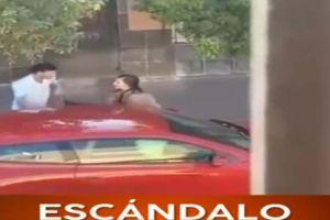 Novia casi rompe puerta de auto de su pareja para sacar a supuesta rival de amores