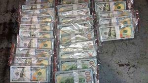 Detectan más $250,000 dólares de billetes falsos con una leyenda en chino al reverso