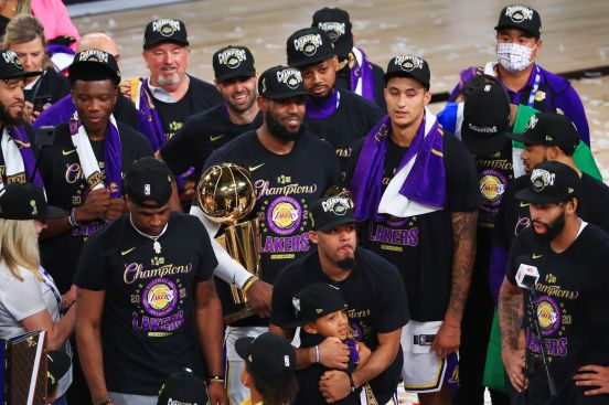Los Angeles Lakers with the Larry O'Brien trophy.