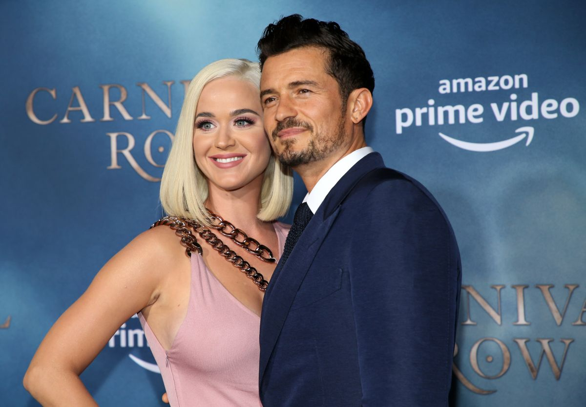 """Katy Perry and Orlando Bloom """"eat kisses"""" on romantic getaway to Italy"""