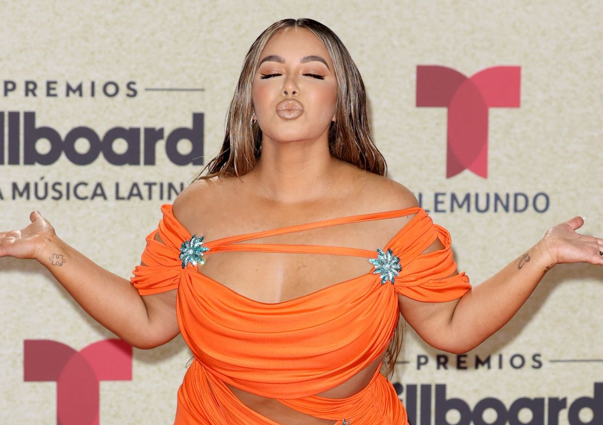 """Chiquis Rivera is shown in vinyl leggings and even moves her body when announcing her perfume """"Reina"""""""